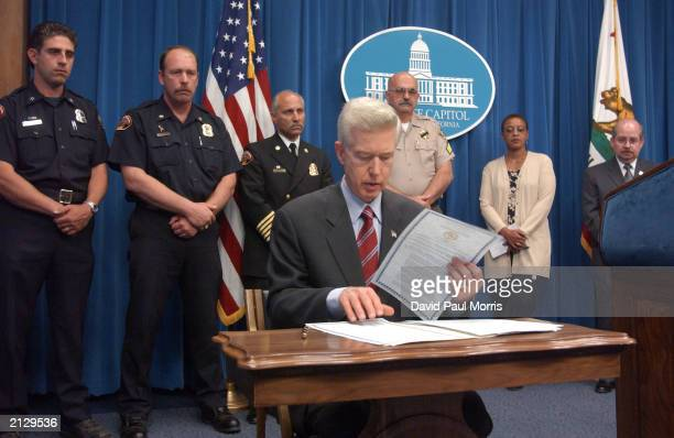 California Governor Gray Davis is seen at a news conference signing in to effect a statewide hiring freeze on state jobs which is expected to save...