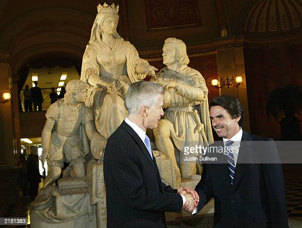 California Governor Gray Davis shakes hands with Spanish President Jose Maria Aznar Lopez in front of a statue of Queen Isabella and Christopher...