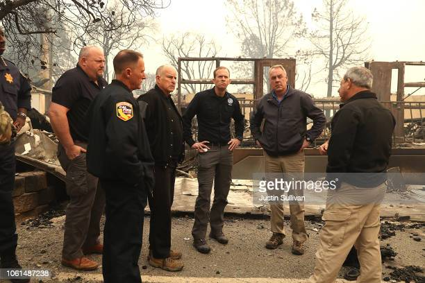California Governor Jerry Brown and FEMA Adminstrator Brock Long and US Secretary of the Interior Ryan Zinke tour a school burned by the Camp Fire on...