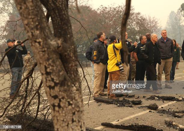 California Governor Jerry Brown and US Secretary of the Interior Ryan Zinke tour a school burned by the Camp Fire on November 14 2018 in Paradise...
