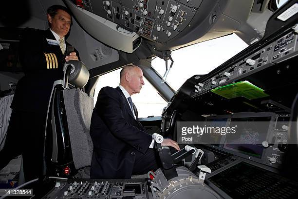California Governor Jerry Brown sits in the cockpit of a new Boeing 787 Dreamliner passenger jet on March 14 2012 in Long Beach California Boeing...