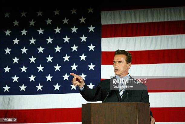California Governor-elect Arnold Schwarzenegger holds a press conference following his appearance with U.S. President George W. Bush October 16, 2003...