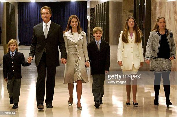 California Governorelect Arnold Schwarzenegger walks with his wife Maria Shriver and their four children to his inaugural ceremony at the State...