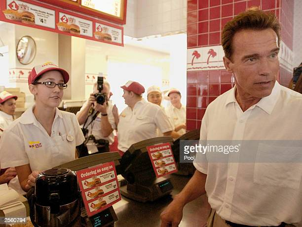 California gubernatorial candidate Arnold Schwarzenegger places an order at an IN Out restaurant during a lunch break on his California Comeback bus...
