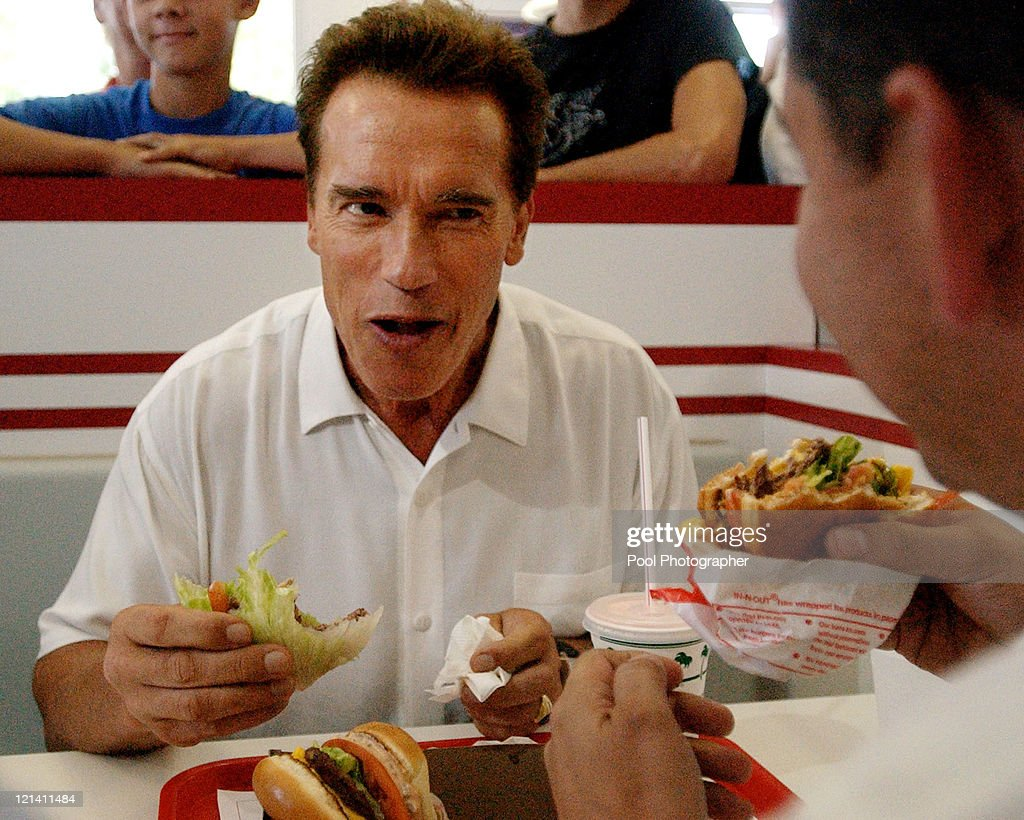 California gubernatorial hopeful Arnold Schwarzenegger eats an 'IN & Out' burger with California Assemblyman Abe Maldonado during a lunch break on his 'California Comeback' bus tour in Merced Calif., Saturday afternoon Oct. 4, 2003.