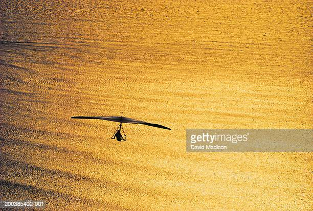 California, hang glider over Pacific Ocean, sunset, elevated view