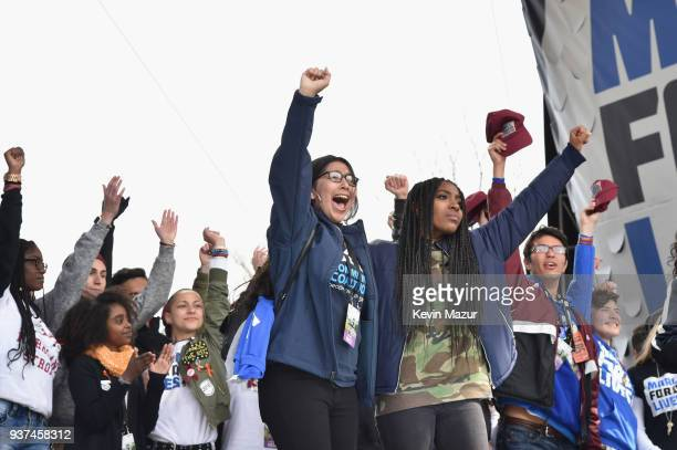 California high school student Edna Chavez cheers onstage with other students at March For Our Lives on March 24 2018 in Washington DC