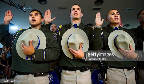 California Highway Patrol cadetes from left to right Arturo Aldrete Christopher Allen and Clayton Alvarez are sworn in Friday July 9 in Sacramento...