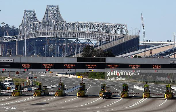 California Highway Patrol officer guards the closed toll plaza leading to the San Francisco Bay Bridge October 28 2009 in Oakland California The San...