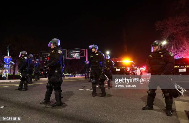 California Highway Patrol officers block an entrance to Interstate 5 as Black Lives Matter protesters march nearby on March 30 2018 in Sacramento...