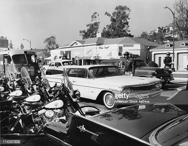 California Highway Patrol officers carry out a traffic check on Sunset Strip, West Hollywood, California, circa 1960.