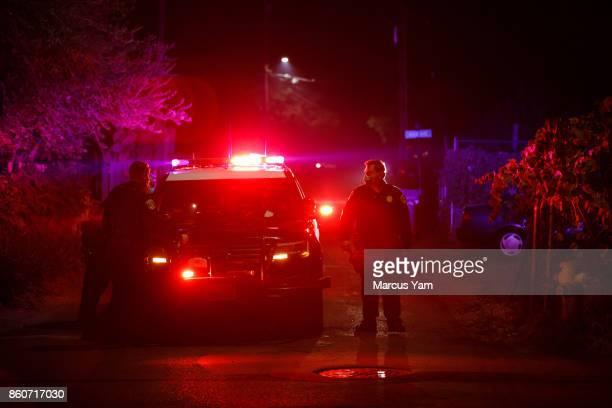 California Highway Patrol officers go door to door in the Boyes Hot Spring neighborhood to tell residents to voluntarily evacuate ahead of the...