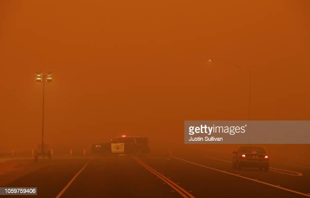 California Highway Patrol vehicle mans a checkpoint along Highway 32 as the Camp Fire burns in the area on November 9 2018 in Chico California Fueled...