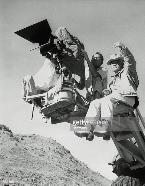 Hollywood 'KnowHowe' His booted feet dangling in midair cameraman James Wing Howe discusses the next shooting sequence with his assistant Howe made...