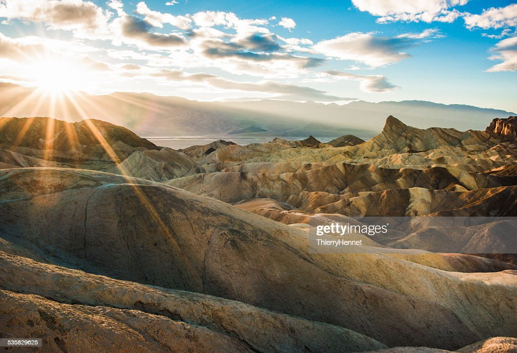 USA, California, Inyo County, Death Valley National Park, Zabriskie Point trail at sunset : Stock Photo
