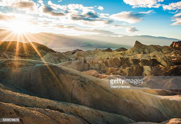 USA, California, Inyo County, Death Valley National Park, Zabriskie Point trail at sunset