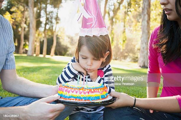 USA, California, Irvine, Portrait of happy family in park celebrating daughter's (4-5) birthday