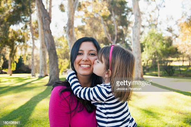 usa, california, irvine, portrait of smiling mother and daughter (4-5) kissing her - irvine california stock pictures, royalty-free photos & images