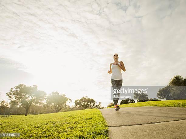 USA, California, Irvine, Woman running in park