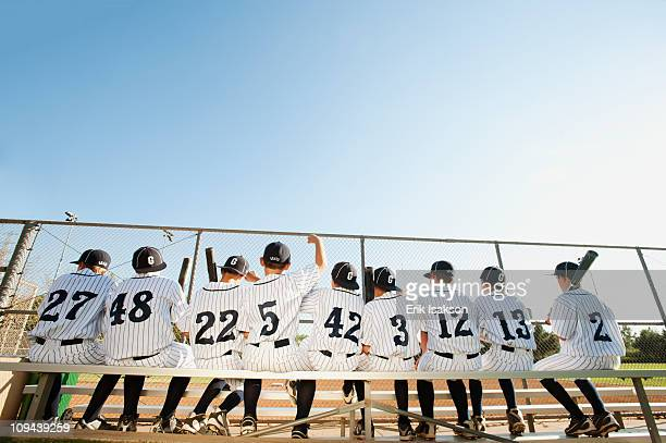 usa, california, ladera ranch, boys (10-11) from little league sitting on bench, rear view - baseball team stock pictures, royalty-free photos & images