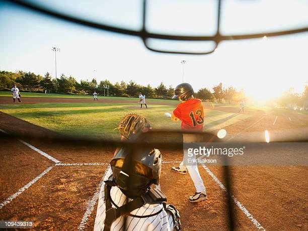 USA, California, Ladera Ranch, boys (10-11) playing baseball seen through helmet