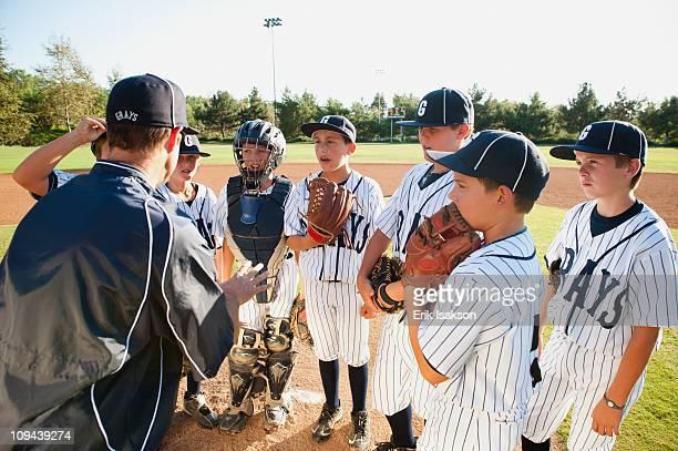 USA, California, Ladera Ranch, coach training little league baseball team (10-11)