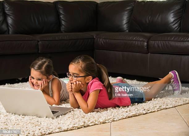 USA, California, Ladera Ranch, Girls (6-7, 8-9) using laptop at home