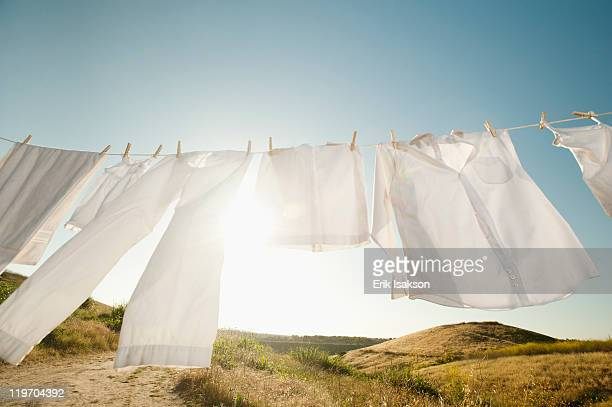 usa, california, ladera ranch, laundry hanging on clothesline against blue sky - drying stock pictures, royalty-free photos & images