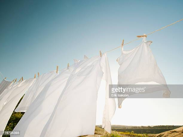 USA, California, Ladera Ranch, Laundry hanging on clothesline against blue sky