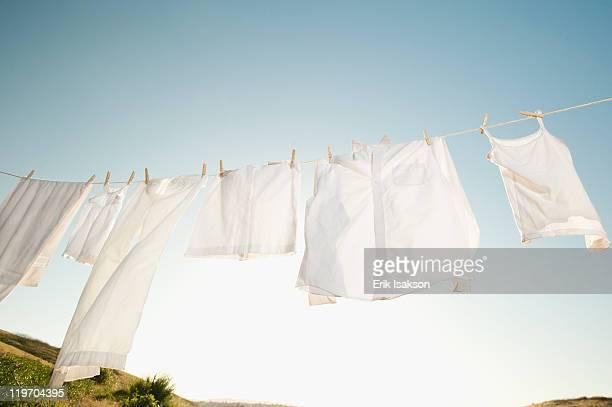 usa, california, ladera ranch, laundry hanging on clothesline against blue sky - 物干し ストックフォトと画像