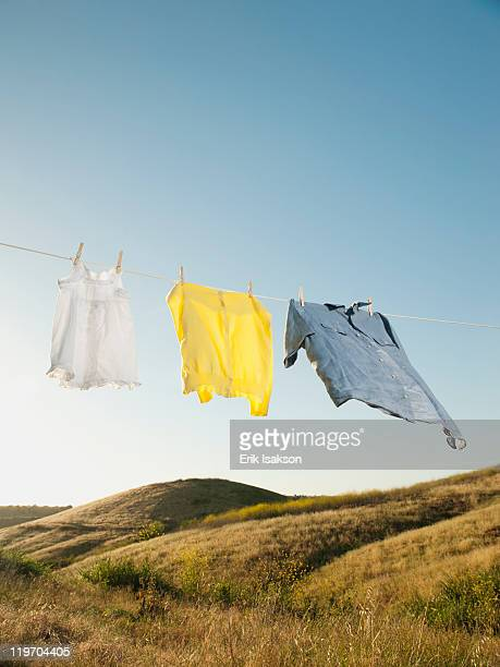 usa, california, ladera ranch, laundry hanging on clothesline against blue sky - 洗濯物 ストックフォトと画像