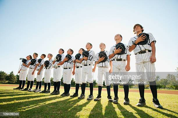 USA, California, Ladera Ranch, little league players (aged 10-11) on field