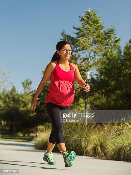 USA, California, Ladera Ranch, Pregnant woman walking outdoors