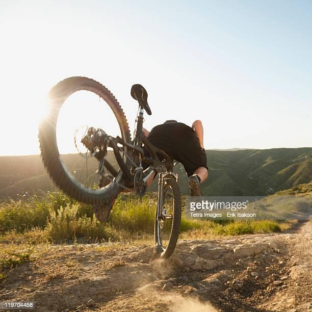 USA, California, Laguna Beach, Mountain biker falling of his bike