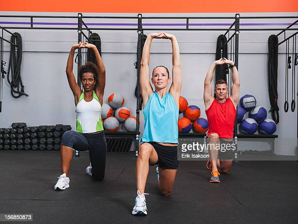 USA, California, Laguna Niguel, Multiracial group of two women doing aerobic in gym