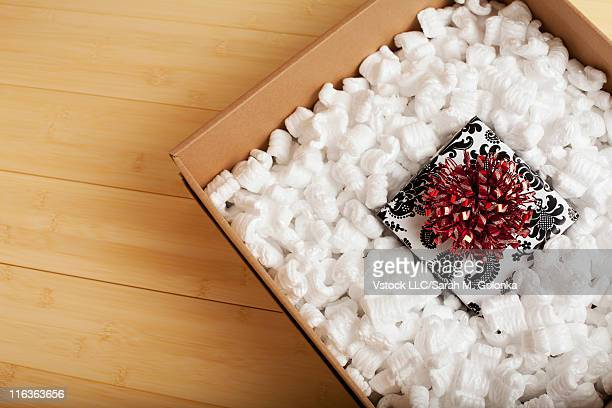 USA, California, Lawndale, Gift in cardboard box filled with styrofoam peanuts