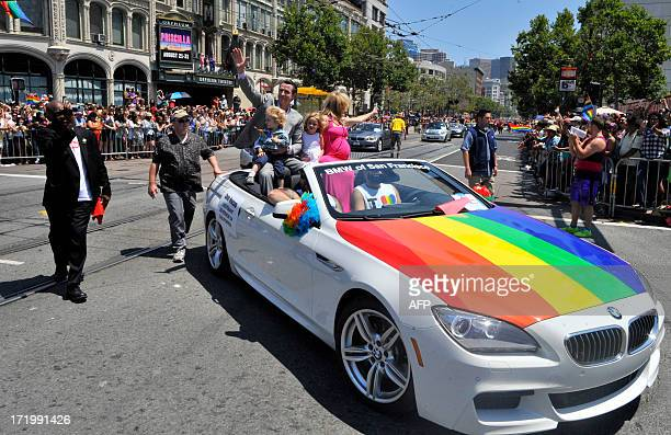 California Lieutenant Governer Gavin Newsom drives with his family along the parade route during San Francisco's Gay Pride festival on June 2013 AFP...
