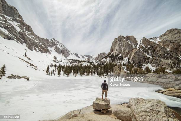 rear view of hiker looking at view while standing on rocks - lone pine california stock pictures, royalty-free photos & images