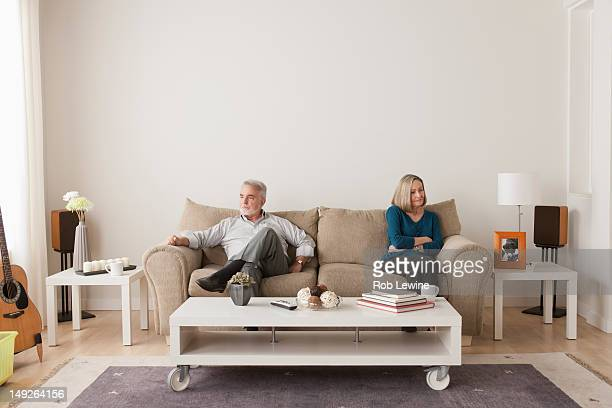 USA, California, Los Angeles, Angry senior couple sitting on sofa
