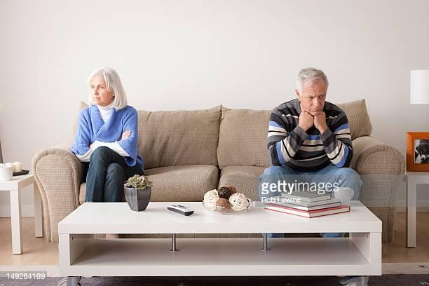 USA, California, Los Angeles, Angry senior couple sitting on sofa
