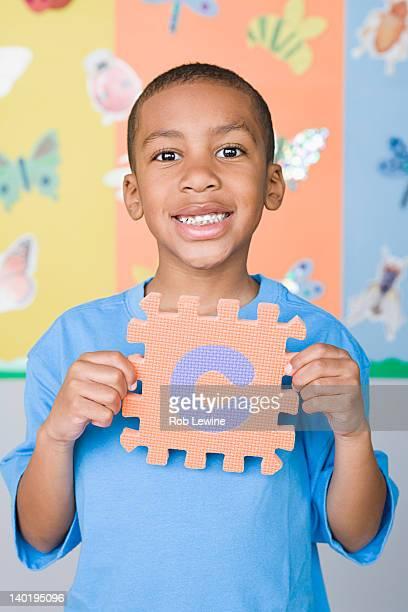 USA, California, Los Angeles, Boy (6-7) holding letter C