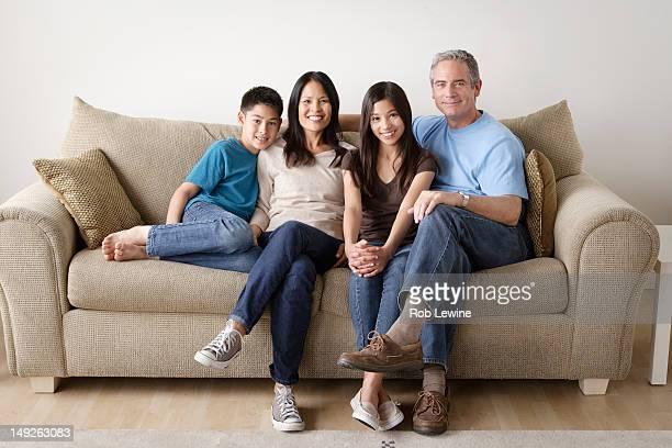 USA, California, Los Angeles, Cheerful family sitting on sofa