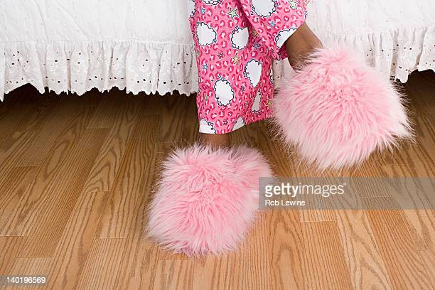 USA, California, Los Angeles, Close up of girl's (10-11) legs in pajamas and slippers