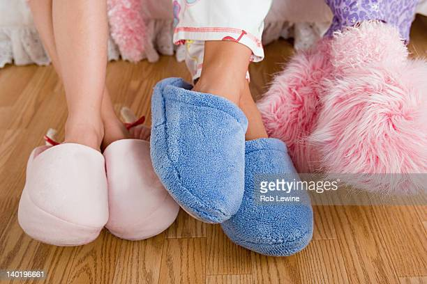 usa, california, los angeles, close up of legs of three girls (10-11) wearing fluffy slippers - fluffy stock pictures, royalty-free photos & images