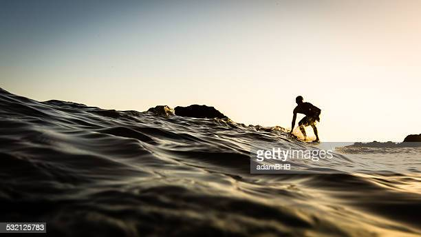 usa, california, los angeles county, malibu, surfer at sunset - adam la stock pictures, royalty-free photos & images