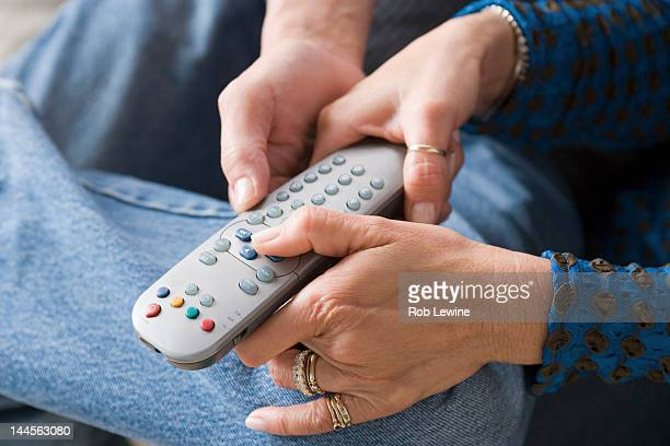 USA, California, Los Angeles, Couple fighting for remote control