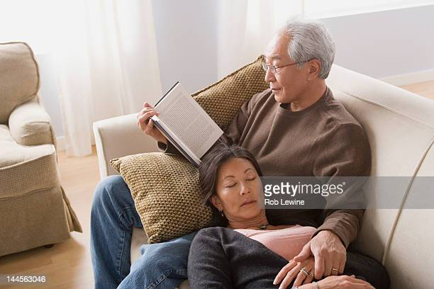 USA, California, Los Angeles, Couple relaxing on sofa