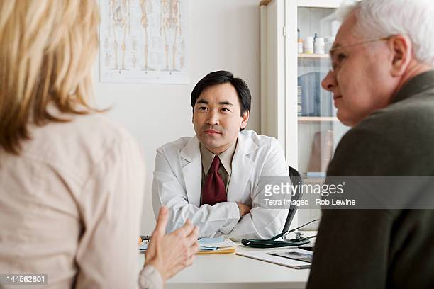 USA, California, Los Angeles, Doctor listening to patients
