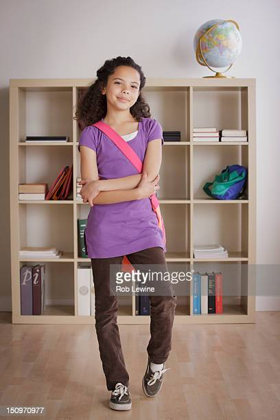 usa, california, los angeles, full length schoolgirl (10-11) standing in classroom - ショルダーバッグ ストックフォトと画像