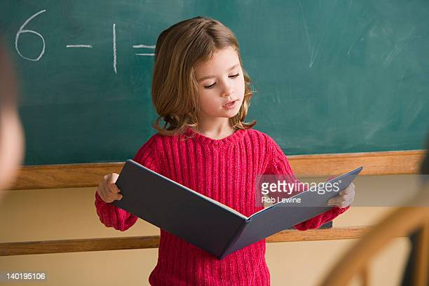 usa, california, los angeles, girl (6-7) having presentation in classroom - child prodigy stock pictures, royalty-free photos & images